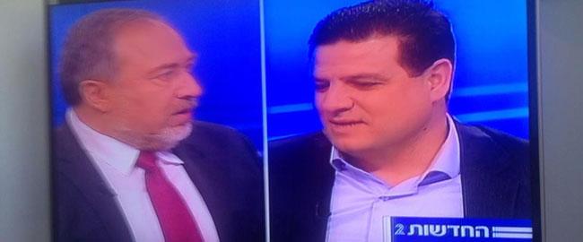 איימן עודה מול אביגדור ליברמן (צילום מסך מתוך העימות בערוץ 2) ayman-liberman