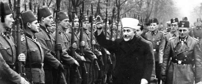 אל חוסייני מצדיע במועל יד לפלוגת וואפן אס-אס בוסנית, 1943 (מקור) Husseini-SS